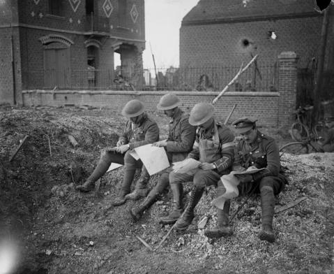 Image © IWM (Q 4957) - Officers of one of the Teritorial Force (TF) battalions studying maps in Peronne, which the British troops entered on 18 March 1917.