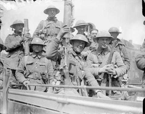Image © IWM (Q 5240) - British troops embussing in Arras to go back for a rest, May 1917.