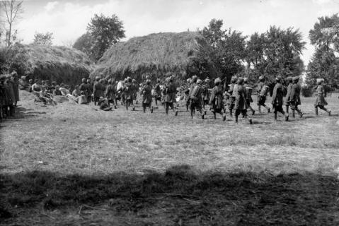Image © IWM (Q 28789) - Band of the 40th Pathans playing in a meadow beside a French village watched by men of the regiment and French civilians.