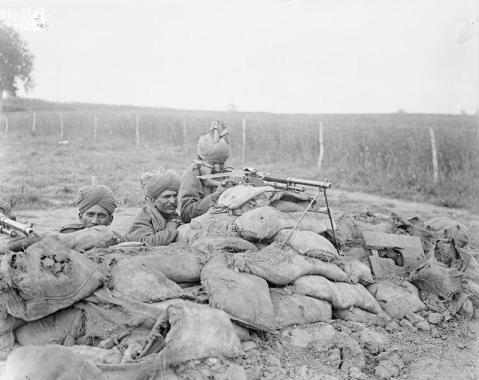 Image © IWM (Q 4070) - Men of Indian Hotchkiss Gun Team practising near Querrieu, 29 July 1916.