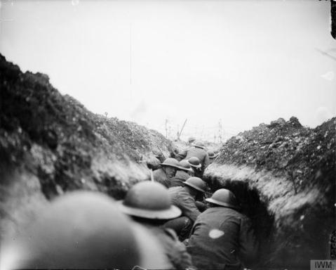 Image © IWM (Q 5098) - A raiding party of the 10th Battalion, Cameronians (Scottish Rifles) waiting in sap for the signal to go. Near Arras, 24 March 1917.
