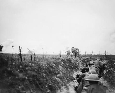 Image © IWM (Q 5101) - A raiding party from the 10th Battalion, Scottish Rifles (Cameronians) leaving a sap and making for the German lines. Near Arras, 24 March 1917.