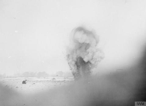 Image © IWM (Q 1687) – An enemy shell bursting near the front line trenches, Beaumont Hamel, December 1916.
