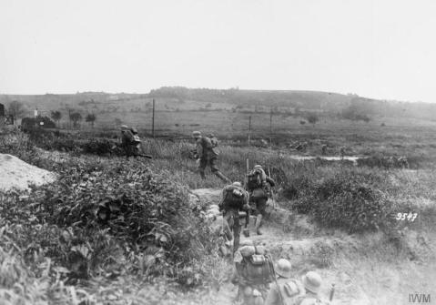 Image © IWM (Q 55009) – German infantry advancing in artillery formation on the Aisne canal.